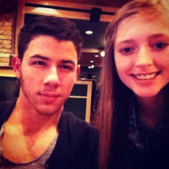 Nick Jonas + a fan at DFW Airport