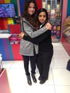 Selena Gomez + a fan at the airport in Michigan