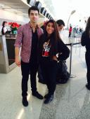 Joe Jonas + a fan at DFW Airport