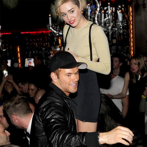 Miley Cyrus + Kellan Lutz at Grand Opening of Beacher's Madhouse in Las Vegas, NV