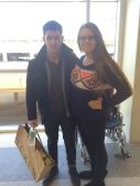 Nick Jonas with a fan at the airport