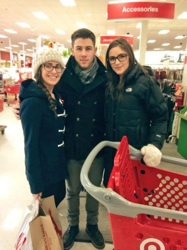 Nick Jonas + Olivia Culpo with a fan at Target at the Warwick Mall in RI
