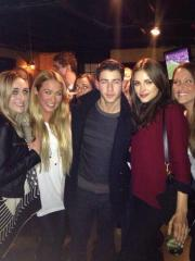 Nick Jonas + Olivia Culpo with fans at Fat Belly's Pub
