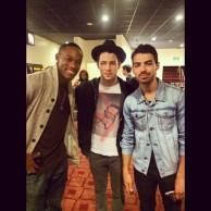 Joe Jonas + Nick Jonas with a fan