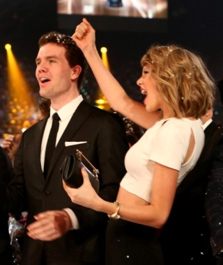 With her brother Austin Swift