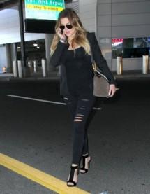 Khloe+Kardashian+Lands+JFK+Airport+MEYYN_7hxtvl