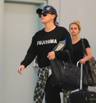 Demi Lovato Wears No Makeup as She Lands in NYC on the Anniversary of her Dad's passing