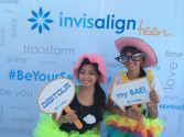 Kissing booth winner in Invisalign booth with friend
