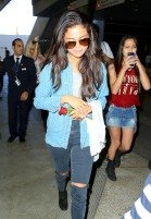 Selena Gomez returns to LA with Cara Delevingne Pt 2