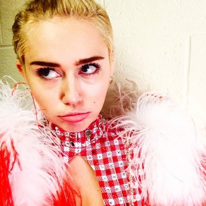 "Miley captioned this photo with ""dem eye bags,"" you are SO not alone Miley!"