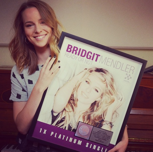Bridgit Mendler pictured with her Platinum plague-2014.