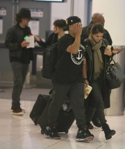 Exclusive... Orlando Bloom & Selena Gomez Depart From LAX At The Same Time