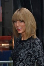 Taylor Swift waves to fans outside Good Morning America studios in New York City