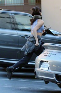 Selena Gomez running into a sound studio as she hides her face in Beverly Hills