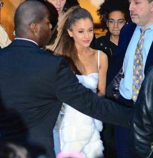 Ariana Grande and her bodyguards leave the Billboard luncheon