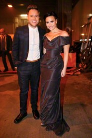 Olly Murs and Demi Lovato are seen backstage at the live X Factor final in London.