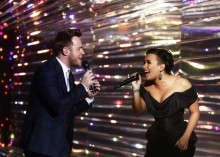Olly Murs and Demi Lovato are seen at the live X Factor final in London.